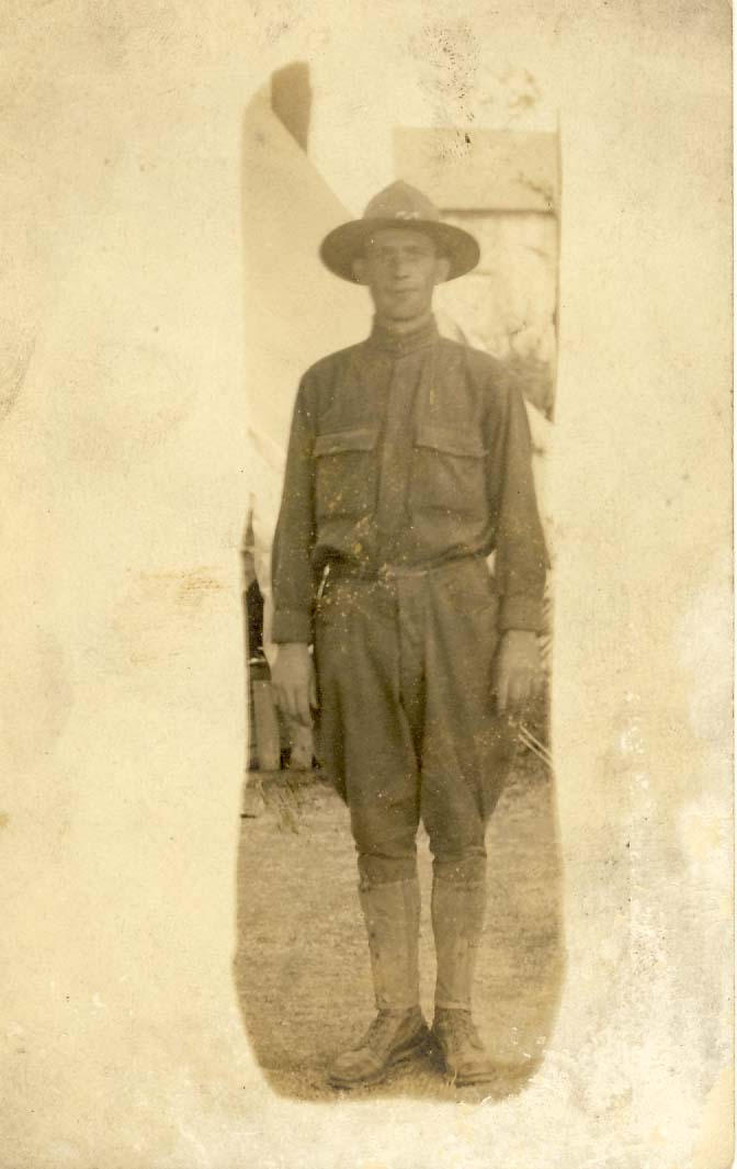 Infantry man, with hat, standing in front of tent photograph