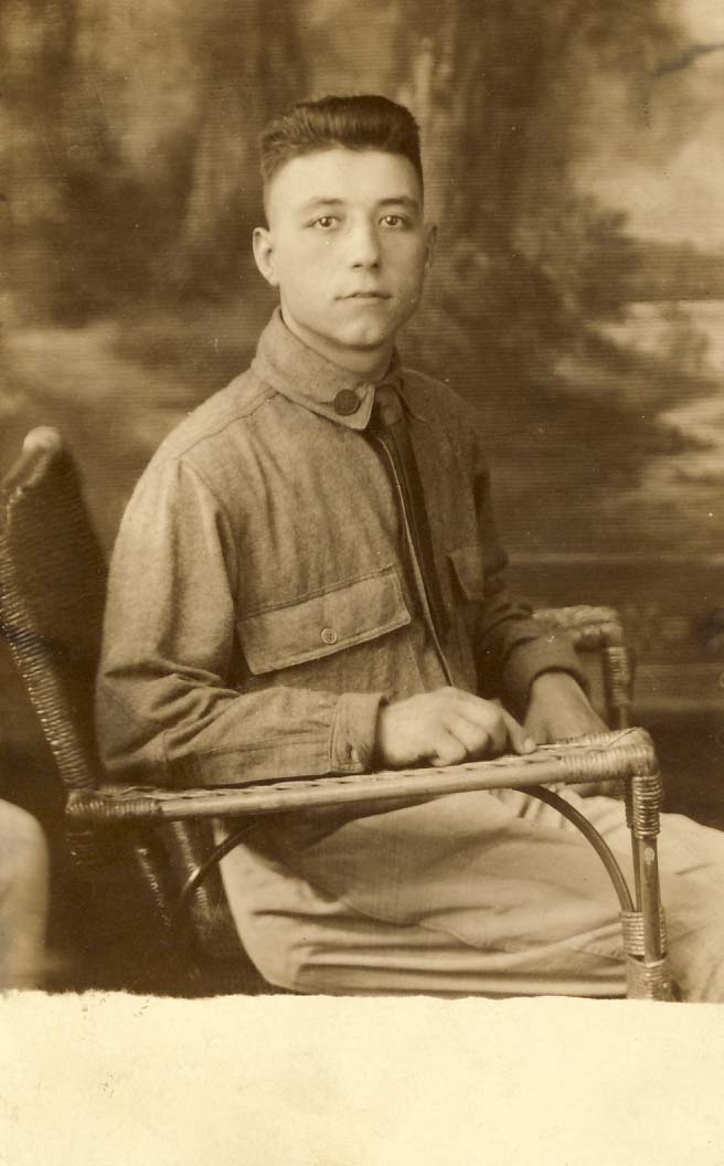 Infantry man, without hat, sitting on wicker chair photograph