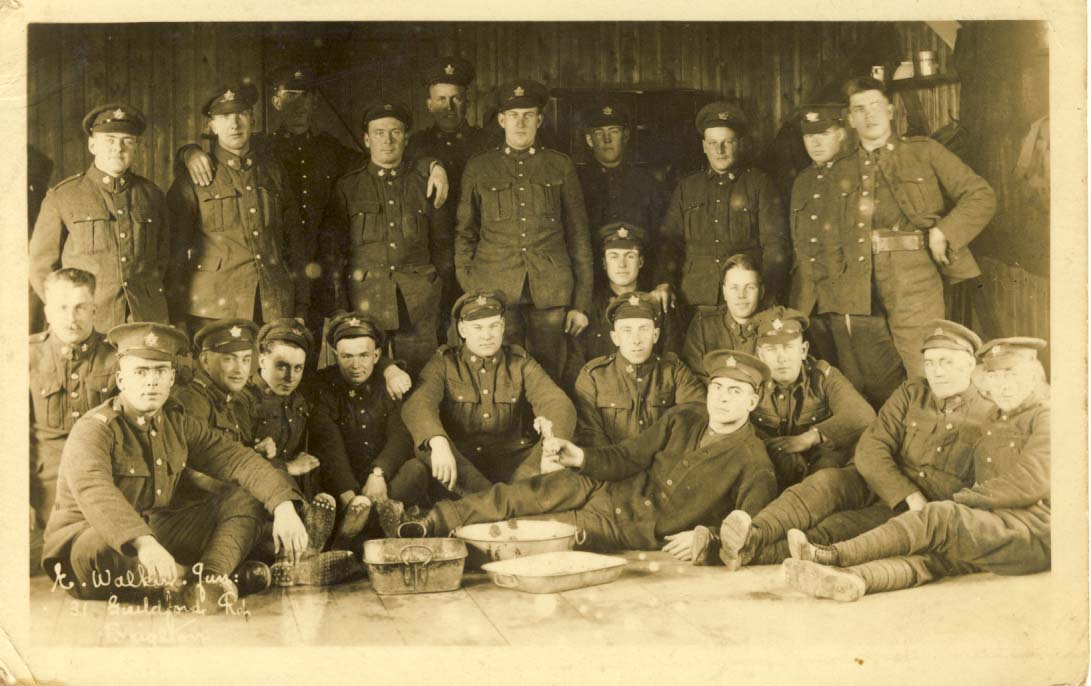 Canadian soldiers, cooking pans in front postcard