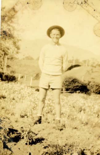 Man in shorts, standing in same garden as Elliot photograph 1933