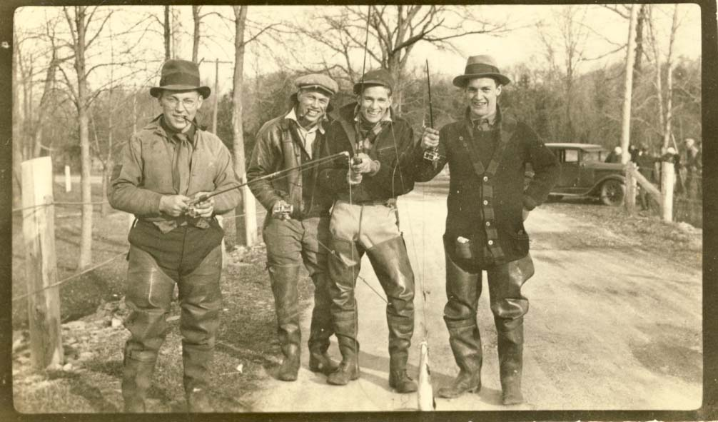 Four men fishing in spring photograph