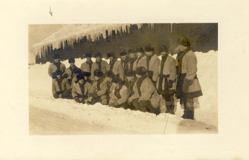 Group of men in winter, wearing hats and mitts postcard