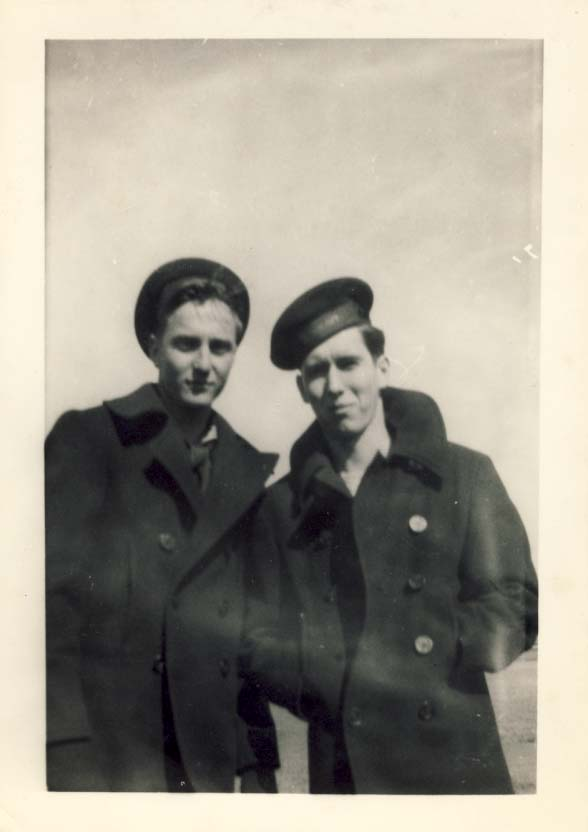Same son, in navy pea coat, standing with friend photograph
