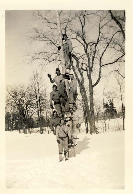 Linemen on pole in winter photograph