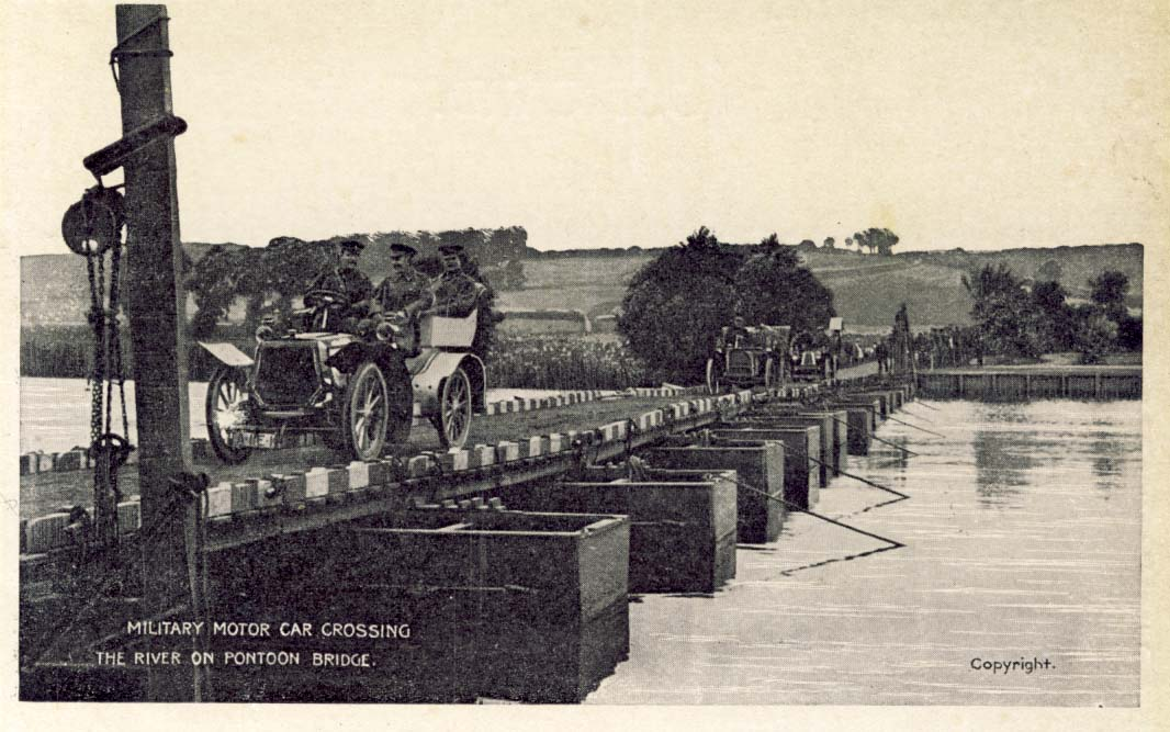 Military motor car crossing the river on pontoon bridge postcard