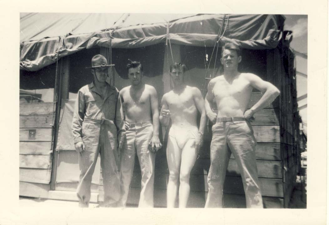 Four soldiers, three shirtless and one in underwear photograph