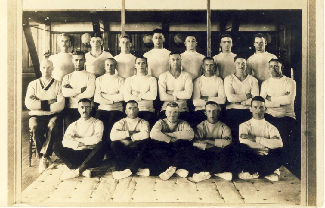 Gym photograph of men in white sweaters postcard