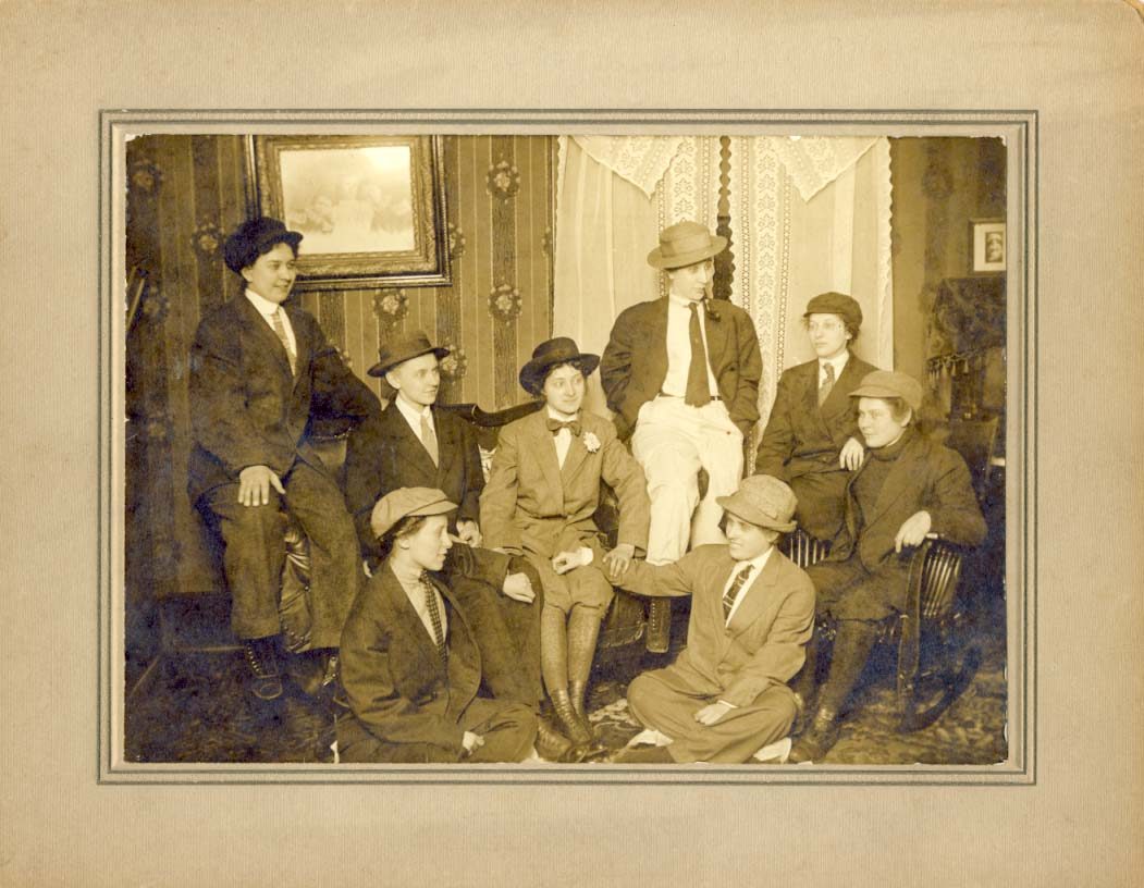 Group of women dressed in men's clothing photograph